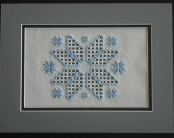 Matted blue star wall hanging