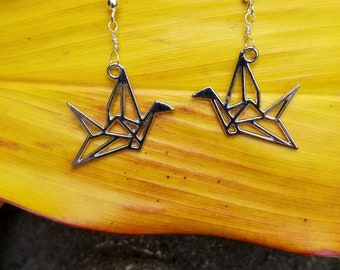Silver origami crane earrings hung from sterling silver wire