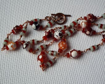 Agate, amazonite, and carnelian beads in a 23 inch necklace