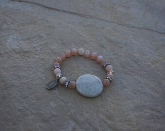 Sunstone beads with large center stone and bronze Blessed Mother Charm
