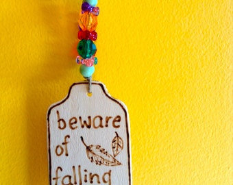 Hanging BIRD TOY / SIGN: 'high-speed flying zone!' & 'beware of falling feathers'
