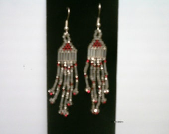 silver and red dangle earrings