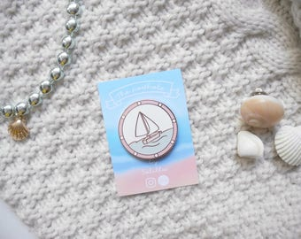The porthole pin / brooch / badge