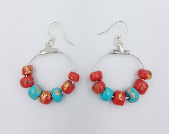 Opulance earrings, polymer beads in red, turquoise and gold leaf,on silver plated hoops, hung on silver plated surgical steel earwires.