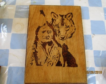 Native American and wolf woodburned picture