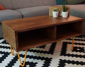 Coffee table in oak and feet pins made of steel.