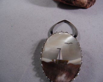 Scarf Clip Made out of Shell with a Boat Scene and Birds.