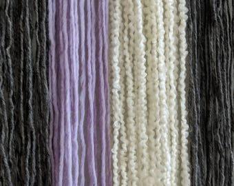 Driftwood and yarn wall hanging