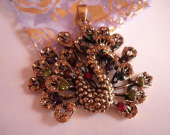 Beautiful antique gold metal and rhinestone Peacock pendant