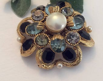 Vintage large round goldtone brooch C 1960 with rhinestones and faux pearl approx 58mm in diameter