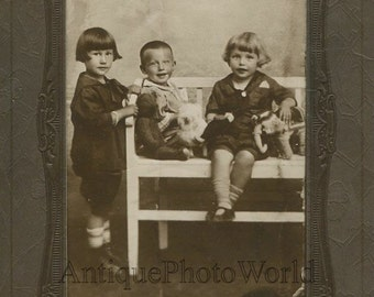 Children with toys teddy bear antique cabinet photo