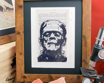 The Frankenstein Monster linocut on upcycled 60's printing of Horror book by Mary Shelley. Limited edition classic movie monster lino print