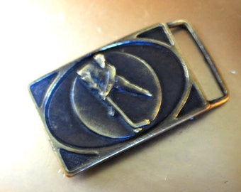 Mod vintage 60s brass , athletic buckle with a hockey player figure.