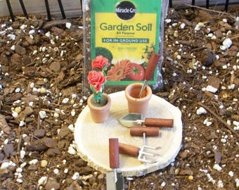 Fairy or gnome Garden miniature potting soil, pots and garden tools