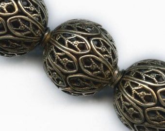 Very high quality oxidized brass filigree bead. 12x11mm. Pkg of  1. b18-0340(e)