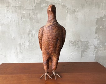 Wood eagle sculpture with metal talons