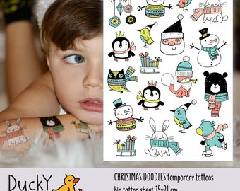 Temporary tattoos set Christamas doodles. Santa Claus, penguin, owl and more Xmas tattoos. Kids stocking stuffers and Christmas favors.