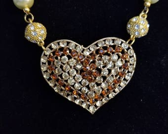 Amber and  Champaign  heart necklace with pearl strand.