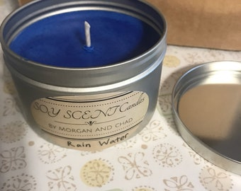 Handmade rain water scented soy wax candle in an 8 oz tin