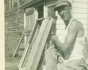 Ed 1940 Working Man Farmer Putting on Coveralls Farm Work Building Vintage Photograph Black White Photo