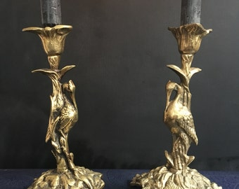 A pair antique Art Nouveau brass candlesticks with a heron in the swamp.