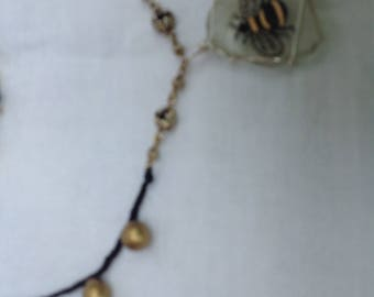 Bee pendant Handpainted on seaglass , wire wrapped and strung with vintage beads and silk