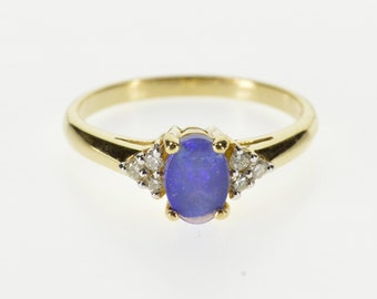 10K Oval Syn. Opal Diamond Cluster Accented Ring Size 7 Yellow Gold
