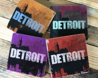 Set of 4 Detroit skyline distressed logo in Warm  Autumn Color Tones, Coasters with cork backing