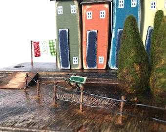 Wonky Little Wooden Houses feature in this Driftwood Sculpture, a Coastal Art piece made from Recycled Wood, a wonderful gift for the home