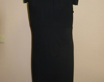 Dress.Knitted fabric. Elastic dress with lining.