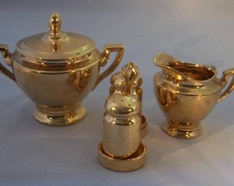 Gold anniversary cream, sugar, salt, pepper, and coffee  pot