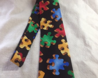 Adult/teen Neck tie made from Autism awareness Large rainbow Puzzle Piece cotton fabric