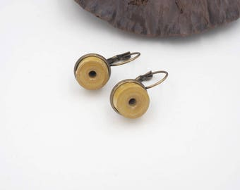 """Duo"" yellow paper cloth and brass earring"