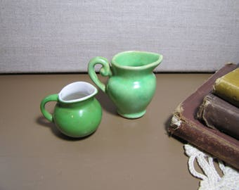 Two (2) Small Green Porcelain and Pottery Pitchers