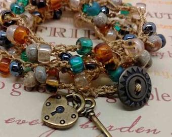 Crochet Wrap Bracelet, Lock and Key Charm, Earthtone Colors,Hippie Earthy Accessory, Bohemian Jewelry, Beaded Wrap Around Bracelet