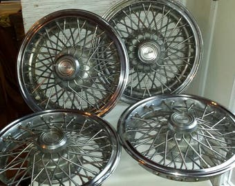 "Automobiliana. Vintage 1970s set of 4 Chevrolet Berlinetta 14"" Hubcaps. Very nice cond, see pics. These are heavy duty. Price reduced 8/9."