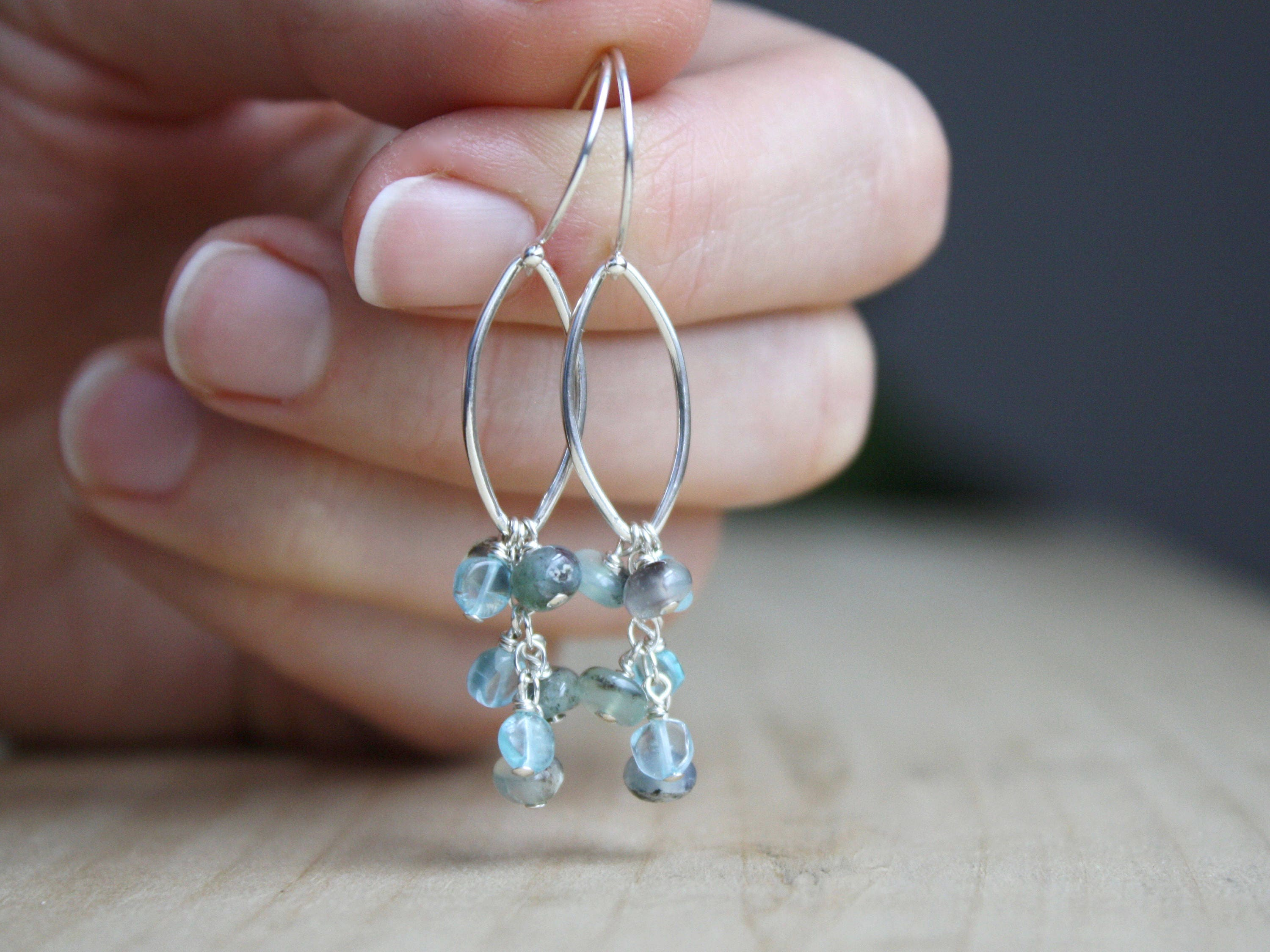 surrounded of earrings topaz in and pin silver briolettes by sterling different apatite wrapped shades