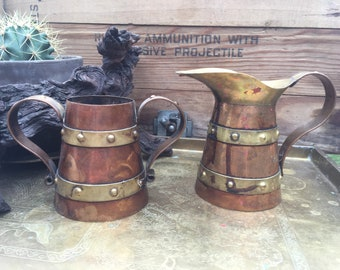 Cooper and brass decorative mugs vases pitchers