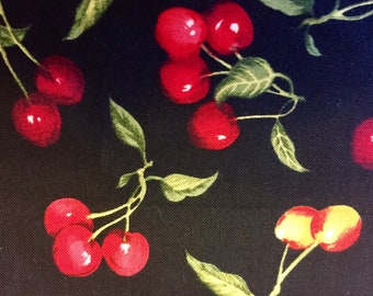 100 percent cotton realistic red burgundy and yellow cherries on black background sewing quilting fabric yardage bthy half yard increments
