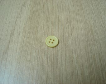small pale yellow round shape button