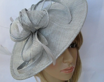 Silver grey metallic Feather Fascinator..Stunning shaped Fascinator on a Headband..