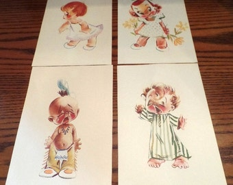 Now marked 20% off. Set of four, adorable art prints of children, circa 1960s.
