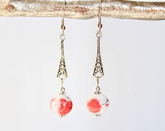 Silver metal and glass pendant earrings on wire hooks