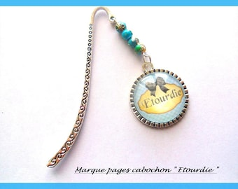 Original fancy bookmark , in silvered metal, with glass cabochon written étourdie, color blue black beige