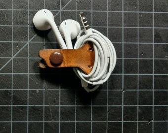 Headphone wrap/keeper