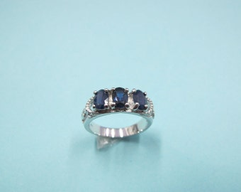 925 sterling silver ring with sapphire.