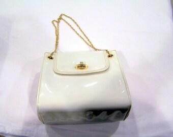vintage MM Morris Moskovitz white purse with white satin interior