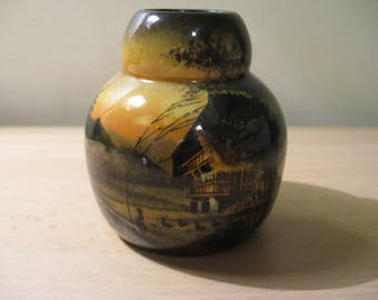 Old decorative vase with images of a farm with animals ...