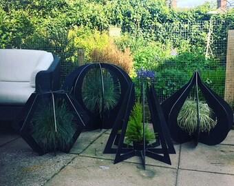 4 Steel Planter Garden Sculptures