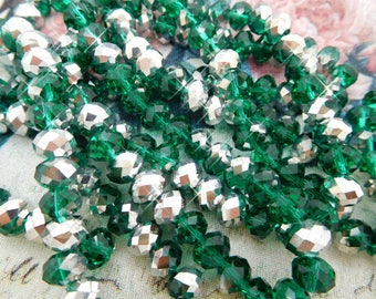 20 Crystal faceted beads emerald green and silver 8x6mm